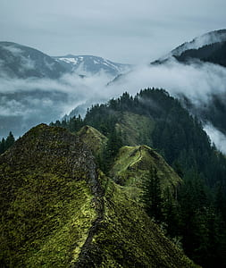 photo of green mountain with clouds