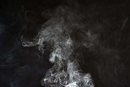 shallow focus photography of smoke with dark background