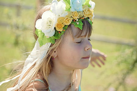 girl in blue spaghetti strap dress with white and yellow roses headband