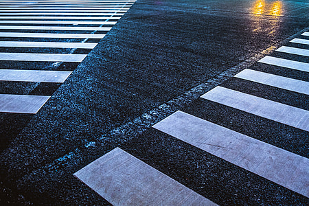 white and black Pedestrian Lane during rainy day