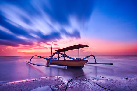 Brown Blue and White Wooden Boat during Orange Sunset
