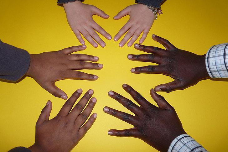 Hands of school children