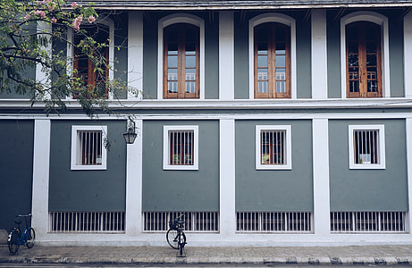 two bicycle in front of a two-storey house