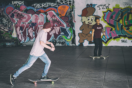 Two skateboarders in action, captured on the Southbank in London, England. Image shot with a Canon 6D DSLR