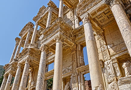 closeup photo of pillars and statues