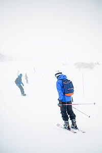 man wearing ski blades and holding ski poles