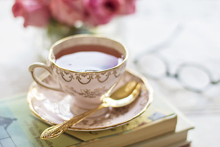 white and gold-colored teacup set