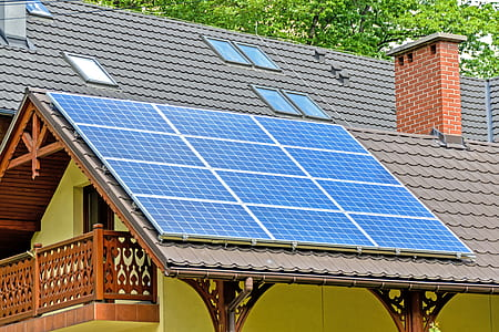 blue and white solar panel on gray roof