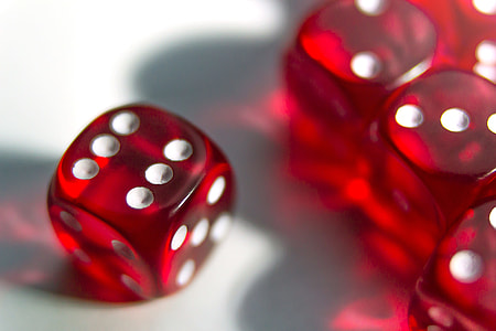 Closeup shot of red playing dice game
