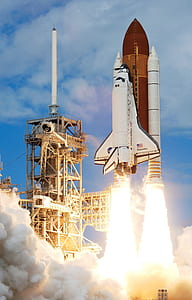 white space shuttle taking off from platform