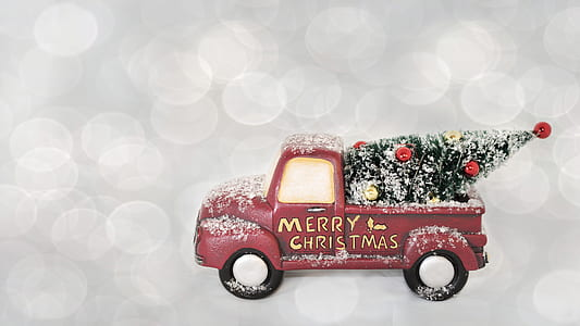 pink pickup truck toy with Merry Christmas text