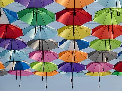 assorted-color handheld umbrella