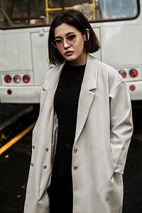 woman wearing black dress and gray coat