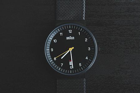 Overhead shot of black wrist watch