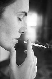 person holding cigarette smoking