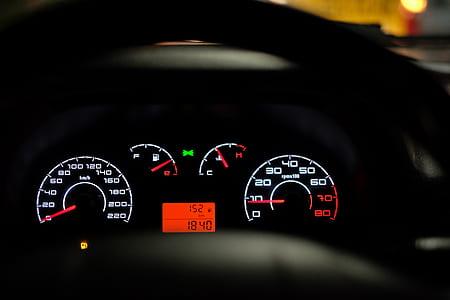black vehicle digital instrument panel cluster