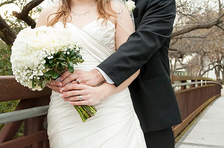woman holds white bouquet