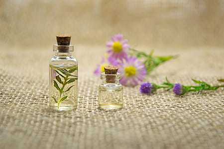 two clear glass vial bottles