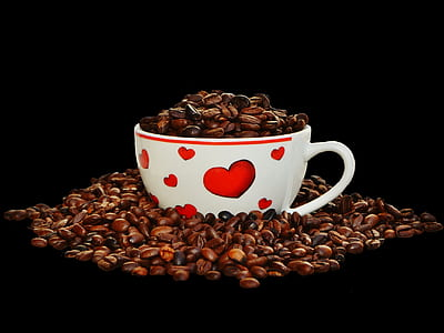 white teacup and coffee beans