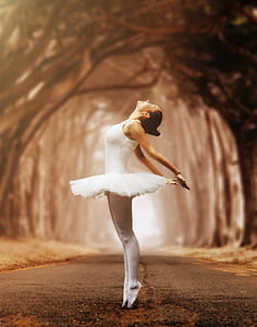 ballerina on concrete road