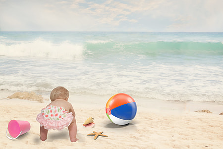 edited photo of baby on beach during daytime