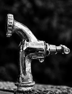 Grayscale Photo Of Stainless Steel Faucet