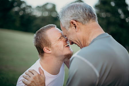 photo of two men nose to nose with each other