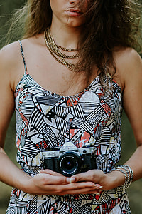 Woman in a dress with a camera