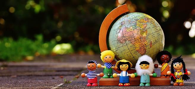 LEGO minifig beside world globe
