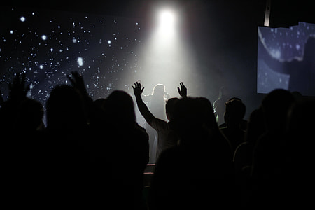 silhouette of peoples watching musical band during nighttime
