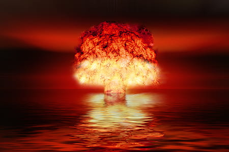 bomb explosion on body of water at night
