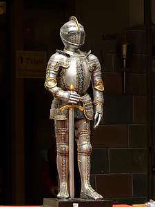 suit of armor holding sword statue