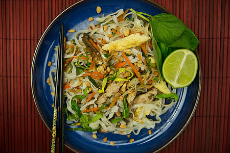 Overhead shot of Pad Thai noodles with chopsticks