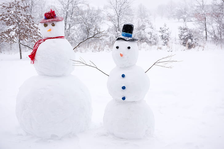 two snowman sculptures