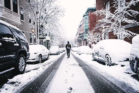 man walking in the middle of street