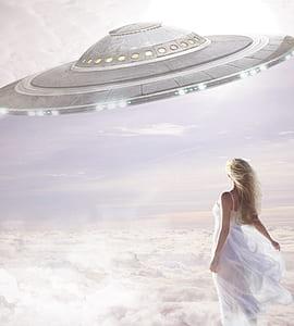 woman wearing dress looking at round spaceship painting