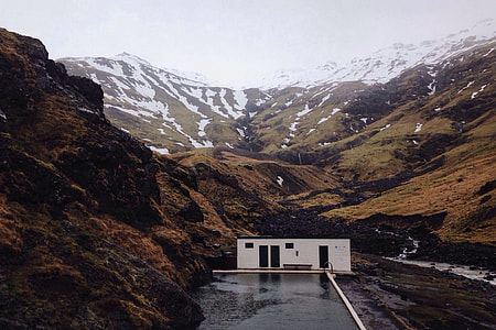 A building sits in the dramatic mountain landscape in Iceland