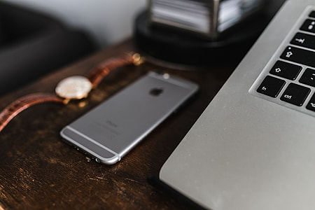 Apple iPhone 6 and Vintage watch on a brown leather wallet
