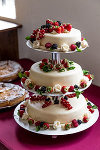 white icing-coated 3-tier cake