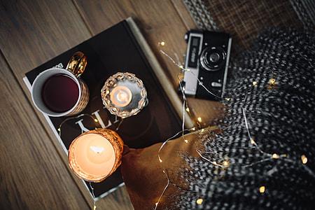 Old camera, mug with tea and books