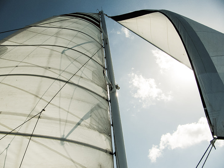 low angle photography of white sailboat during daytime