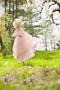 girl wearing pink dress
