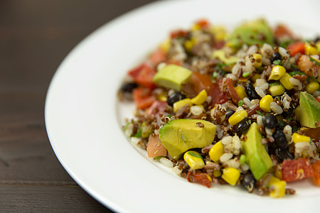 Mexican salad with rice, beans, quinoa and avocado