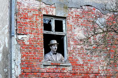 Charlie Chaplin on window