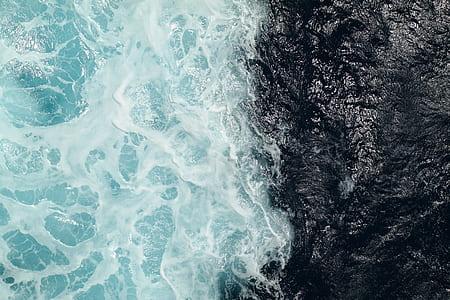 rock by body of water