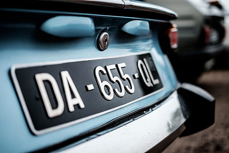 focus photography of car's license plate