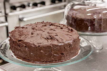 chocolate fondue cake on glass cake stand