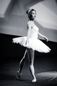 grayscale photo of woman in ballet dress
