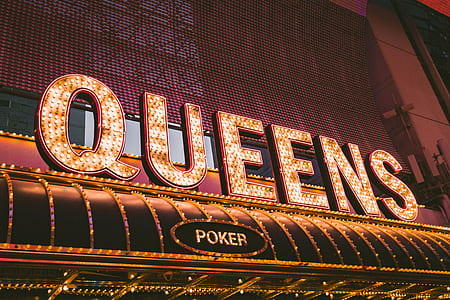 Queens Poker LED signage during nighttime