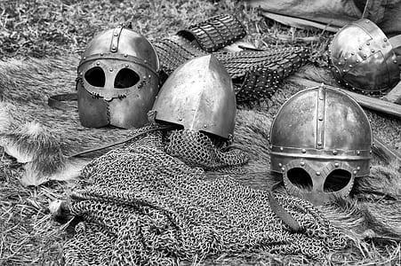 grayscale photo of iron helmets